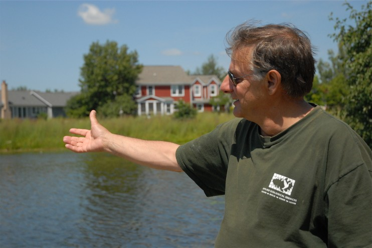 Steve Apfelbaum shows us the lake at Prairie Crossing where the water has been filtered by the native landscape and is pure enough to swim in
