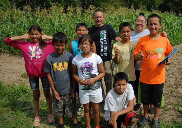 Seneca students learn about native plants including growing and harvesting the traditional Three Sisters natives, corn, beans and squash.