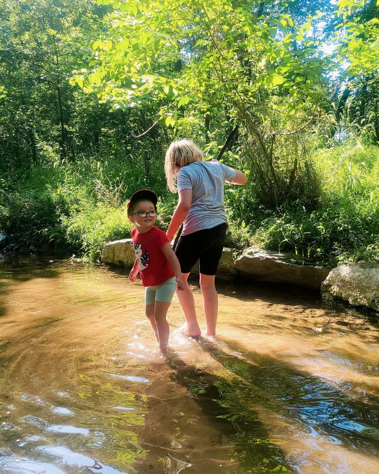 Two girls wading in the water